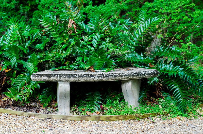 Wesley Monument bench in garden at Christ Church on St. Simons Island, Georgia