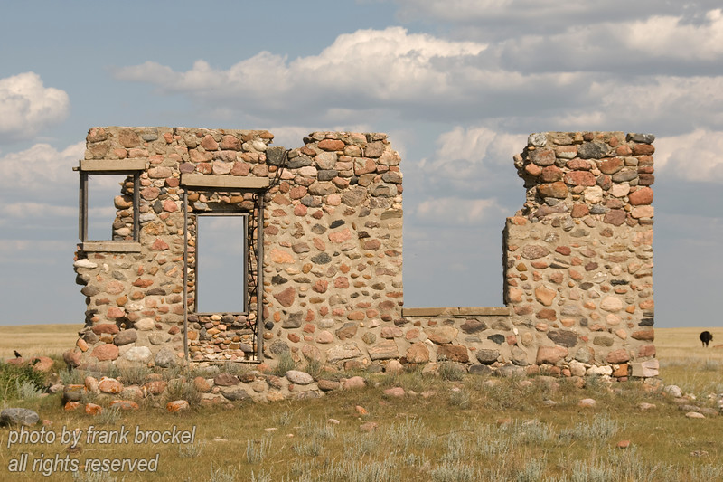 All that's left are parts of the walls and foundations of an abandoned farmstead north of Brooks, Alberta, Canada