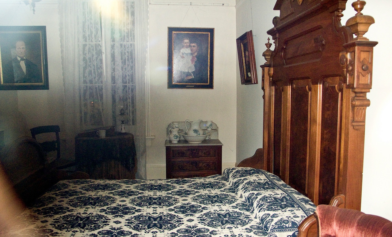 Bedroom in Whaley House.   I didn't see the ghost, but the camera found it.