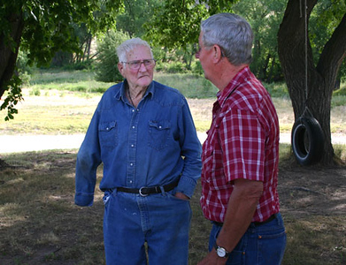 On July 7, 2007, long-time Whitney area resident Bob Lemmon (left) spent an hour or so visiting with Bob Galey (right) and Larry Miller about days gone by.  <br /> <br /> Bob's ancestors came to the United States from Ireland.  They eventually settled in northwest Nebraska.  His mother and father were married shortly after the turn of the century, and his mother (Anna Neece Lemmon) completed her education at the old Normal School in Chadron before becoming a teacher and then raising her family.<br /> <br /> Bob attended the Whitney School and graduated in 1931.  Within three weeks, he went  Pine Ridge in South Dakota, where his father had leased 90 sections of land for 5 cents an acre.  They started with 800 head of cattle and returned six years later with 2,800 head.
