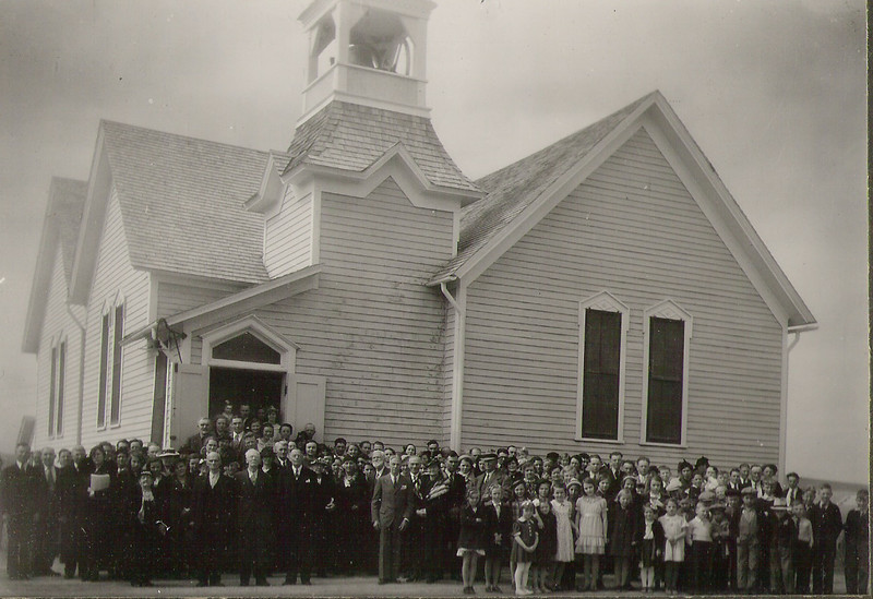 "Early undated photo of Warring UMC congregation, Whitney Nebraska.   Notice entry is on the east side of the church. Choose ""XLarge"" for best view."