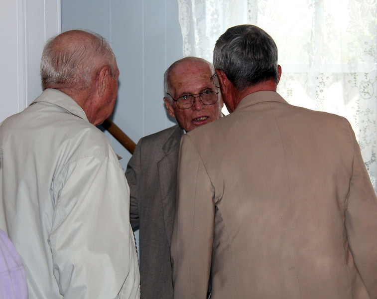 Earl Gue (left) and Bob Galey (right) listen to Leo Daniels - 25 Mar 2012