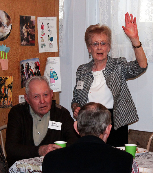 Jerry Hartman listens as Shirley Hartman volunteers a story - 25 Mar 2012