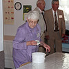 Naomi Galey helps clean up while men supervise - 25 Mar 2012