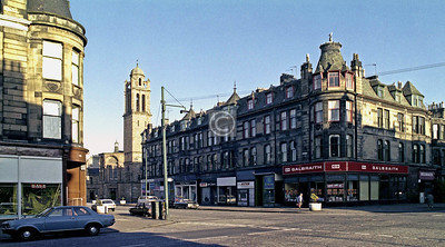 Albert Cross, junction of Albert Dr and Kenmure St. Traffic lights, different shops, otherwise much the same.    August 1978
