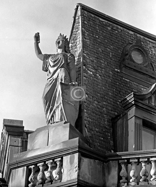 Corner of Queen's Dr and Langside Rd.   These Parisian-style tenements were built a year or two after the real Statue of Liberty was erected.    February 1976