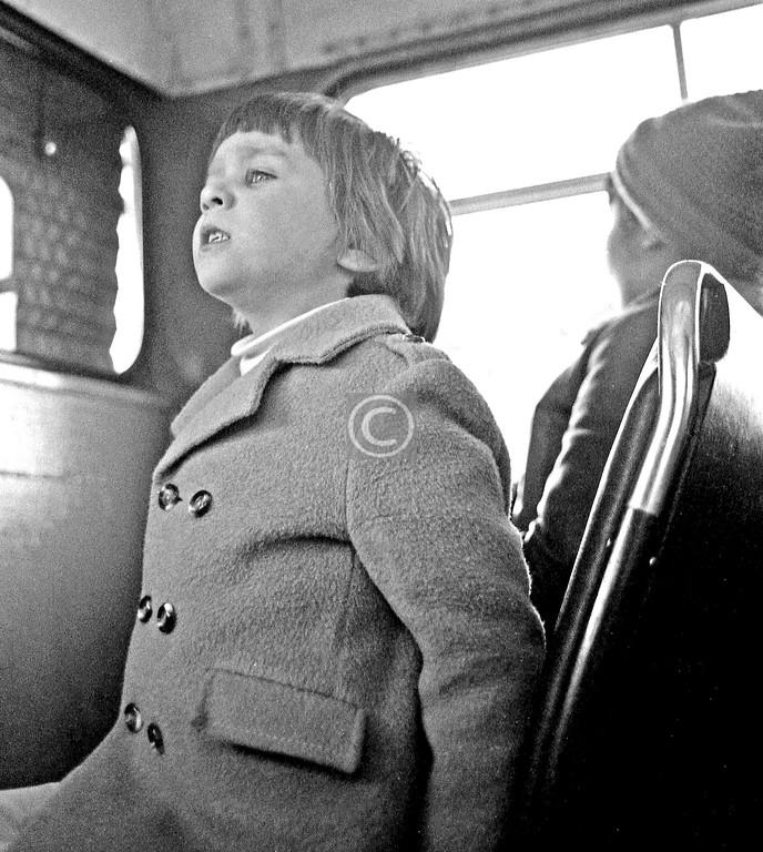 Restless child on said bus.