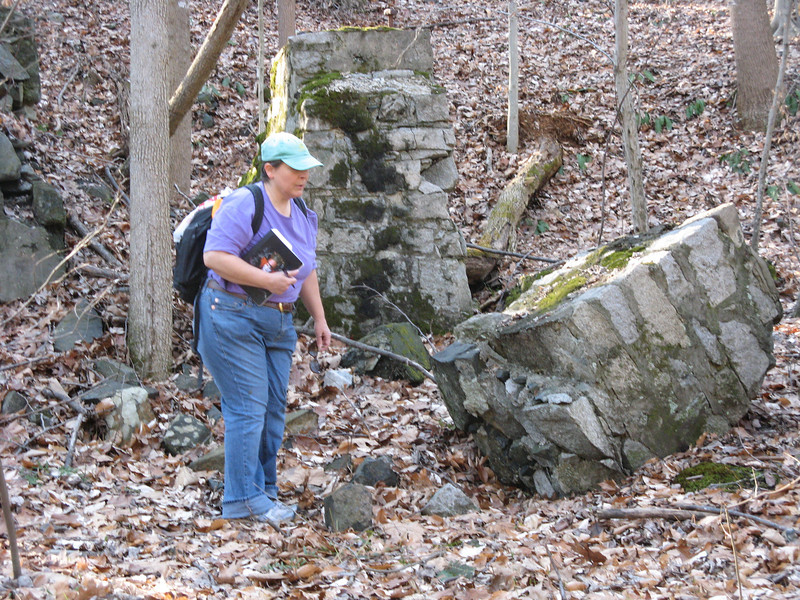 Wendy looking at ruins of a building at the abandoned gabbro quarry on an extension of the Wincopin Trail along Little Patuxent River.<br /> <br /> 1-7-12