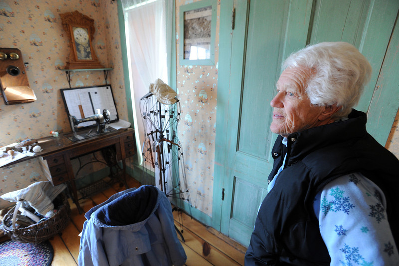 "Sarah Wise reflects on her grandparents homestead on Friday.<br /> The Wise Homestead Museum in Erie is hosting a ""Homestead Christmas"", on Saturday, December 15th, 2012.<br />  For a video and more photos of the homestead, go to  <a href=""http://www.dailycamera.com"">http://www.dailycamera.com</a>.<br /> Cliff Grassmick  / December 7, 2012"