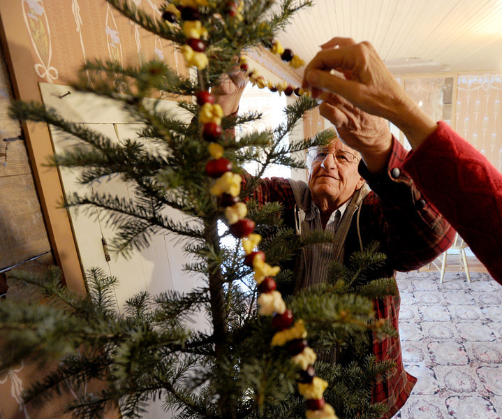 "Alan  Wise decorates a Christmas tree in a traditional manner in his family's 1870's homestead on Jasper Road in Erie.<br /> The Wise Homestead Museum in Erie is hosting a ""Homestead Christmas"", on Saturday, December 15th, 2012.<br />  For a video and more photos of the homestead, go to  <a href=""http://www.dailycamera.com"">http://www.dailycamera.com</a>.<br /> Cliff Grassmick  / December 7, 2012"