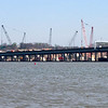 April 13, 2005:  Lots of cranes at work behind the old bridge -- as seen from a point upstream.