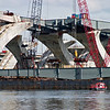 January 30, 2006:  Cranes preparing to take steel beam from barge and place on piers.