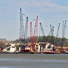 April 13, 2005:  A flotilla of barge-mounted cranes assembles the multiple pre-cast sections of the supporting piers.