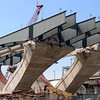 April 13, 2005:  Huge steel beam sections are then fastened onto the piers.