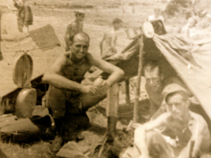 This is probably a bivouac area on Okinawa. The bloodiest battle of the Pacific Theater had recently been concluded. It lasted from April to mid-June 1945. Lt. McClave (left) missed the action, because it was during his training.