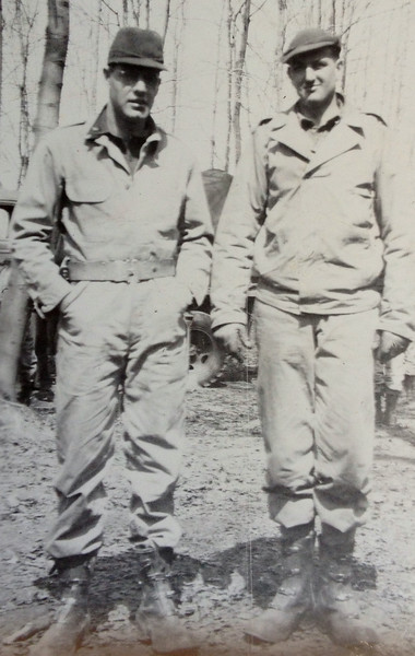 This photo may be after he has joined the paratroopers. If so it is Lt. McClave on the right.