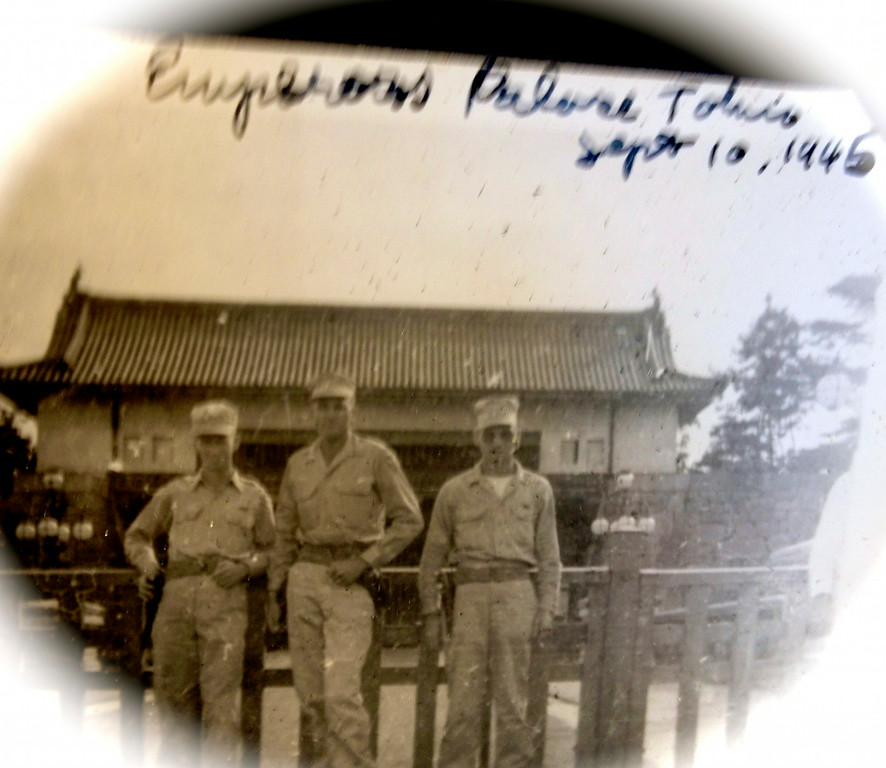 Lt. McClave (middle) poses with comrades-in-arms outside the Emperor's Palace on September 10, 1945. The Allied Forces carefully avoided bombing the compound and harming the emperor. Much of Tokyo was destroyed in bombing campaigns.