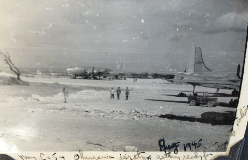 This is the airstrip on Okinawa. It was from this airstrip that were launched many bombing raids over Japan. Perhaps the Enola Gay took off from this airstrip in August 1945. In the rear is the kind of plane, C-54, which will take Lt. McClave and his unit to an airfield outside Yokohama on August 30, 1945.