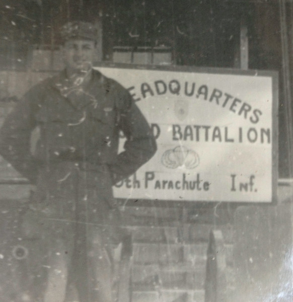 Lt. McClave poses outside the HQ of his battalion in the 188th Parachute Infantry Regiment.