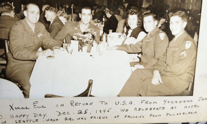 After a two-week voyage on the USS Admiral Coontz, which left Yokohama on December 15, 1945, Lt. McClave (left) enjoys a nice dinner at a hotel in Seattle on Christmas Eve. O Happy Day, indeed!