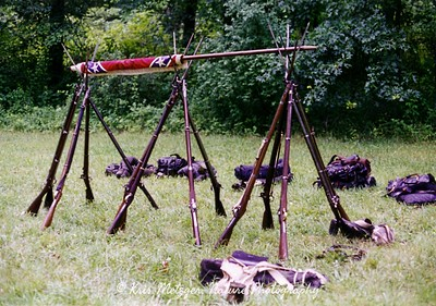 Weapons in bivoac, rebel encampment, reenactment, June 1998, Gettysburg PA.