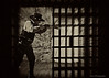 'THE SHERIFF'  The gunfighter photo was taken at the shooting range, and the jail cell photo was taken at the Yuma Territorial Prison. I combined the two photos to create this image.  Can you find the two originals?