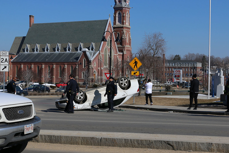 A white Toyota Camry was involved in a hit and run at the intersection of Main Street and Water Street on Thursday afternoon and ended up on it's roof.  SENTINEL & ENTERPRISE/JOHN LOVE