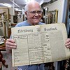 Dick Fiorentino owner of Hobart Village Mall Antiques shows off a Fitchburg Sentinel he has for sale at his shop in Townsend. SENTINEL & ENTERPRISE/JOHN LOVE