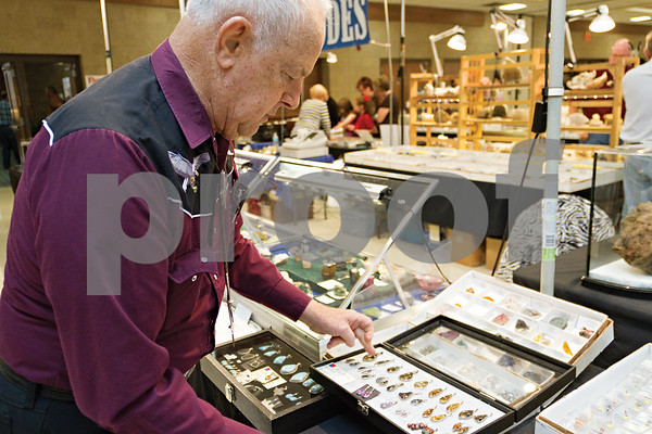 Photo by Shannon Wilson / Tyler Morning Telegraph Ed Wheeler shows the jewelry he has created from silver and stones at the East Texas Gem and Mineral Show at the Rose Garden Center.  The show runs Friday thru Sunday.