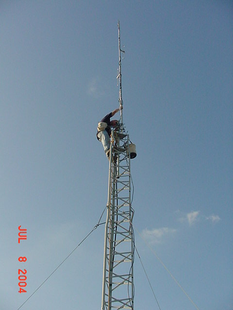 Mike, KB9SGN installing the new four bay dipole antenna. A job well done.
