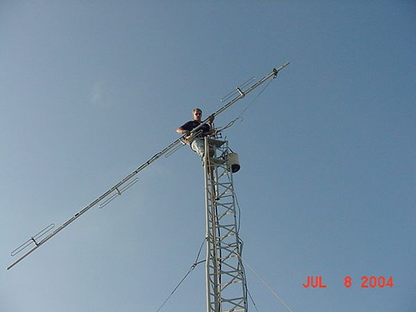 Mike, KB9SGN installing the new four bay dipole antenna.