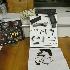 Lower gun is a Russian made 1/2 scale 1911. All parts appear to have been machined ..no castings.