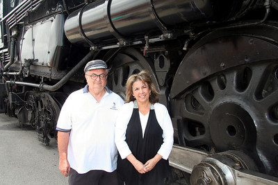 Bill & Arleene standing by the drive wheels of the 3751