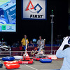 Notice the eyes of the two Refs. Why are they so fixated? Because our minibot is beating the best running minibot at this competition. Look in the top left corner. On the big screen is a broken down, no longer the best minibot.