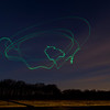 I love this one... it's a heli, which kind of drew a heli in the air with light. I see the loop at the left as the tail rotor, the circles around as the main rotor, and the loop in the center is kind of canopy shaped.