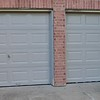 New paint on the garage doors.  New boards installed and primed.