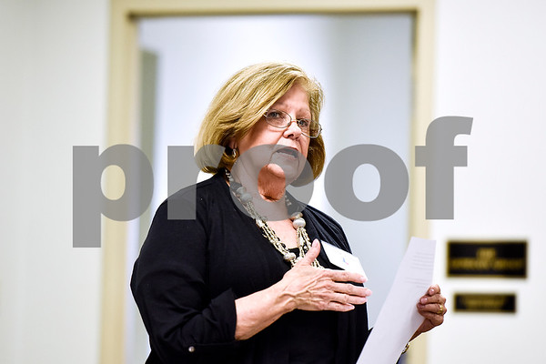 East Texas Writers Guild Vice President Nancy Brown Larson speaks during a East Texas Writers Guild meeting at the Tyler Area Chamber of Commerce on Monday, May 8, 2017. Multi-published author James R. Callan spoke to the group about writing dialog. (Chelsea Purgahn/Tyler Morning Telegraph)