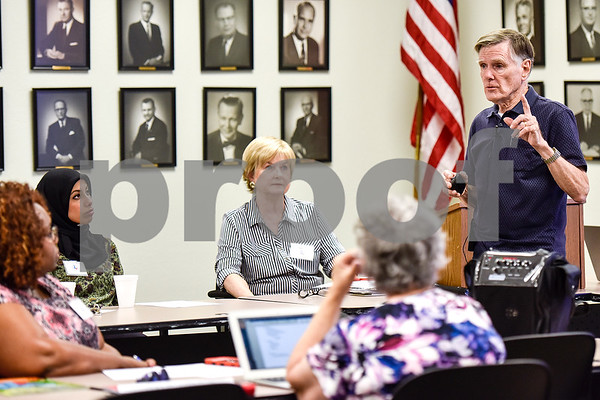 Multi-published author James R. Callan speaks during a East Texas Writers Guild meeting at the Tyler Area Chamber of Commerce on Monday, May 8, 2017. Callan spoke to the group about writing dialog. (Chelsea Purgahn/Tyler Morning Telegraph)