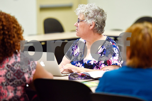 East Texas Writers Guild member Marsha Graham listens during a East Texas Writers Guild meeting at the Tyler Area Chamber of Commerce on Monday, May 8, 2017. Multi-published author James R. Callan spoke to the group about writing dialog. (Chelsea Purgahn/Tyler Morning Telegraph)