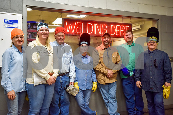 From left to right, Beth Guinn, Pamela Melser, David Henderson, Caroline Sanchez, Ryan Henderson, Michael Baley and Wendy Melser pose for a photo during a sculpture welding class at Tyler Junior College's west campus in Tyler, Texas, on Thursday, June 22, 2017. The class introduces students to the basics of welding and allows them to work on their own creative projects. (Chelsea Purgahn/Tyler Morning Telegraph)