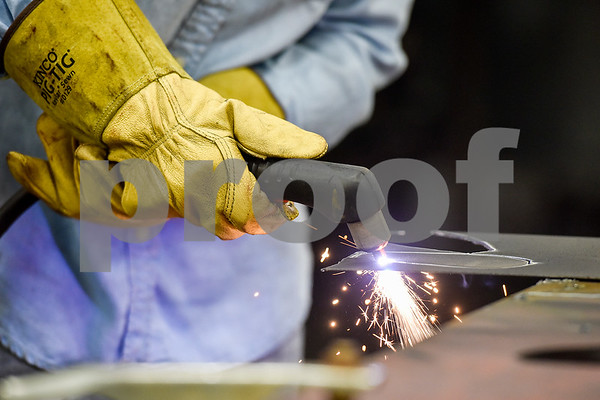 Beth Guinn cuts pieces of metal during a sculpture welding class at Tyler Junior College's west campus in Tyler, Texas, on Thursday, June 22, 2017. The class introduces students to the basics of welding and allows them to work on their own creative projects. (Chelsea Purgahn/Tyler Morning Telegraph)