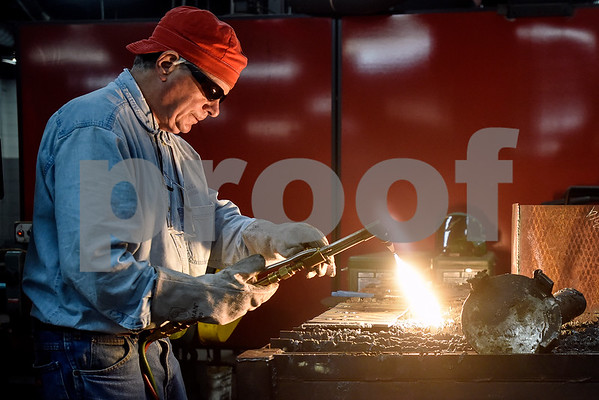 David Henderson works on his project during a sculpture welding class at Tyler Junior College's west campus in Tyler, Texas, on Thursday, June 22, 2017. The class introduces students to the basics of welding and allows them to work on their own creative projects. (Chelsea Purgahn/Tyler Morning Telegraph)