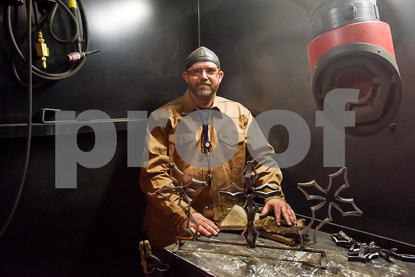 Ryan Henderson poses for a photo with some crosses he made during a sculpture welding class at Tyler Junior College's west campus in Tyler, Texas, on Thursday, June 22, 2017. The class introduces students to the basics of welding and allows them to work on their own creative projects. (Chelsea Purgahn/Tyler Morning Telegraph)