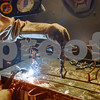 Ryan Henderson welds crosses to a bar during a sculpture welding class at Tyler Junior College's west campus in Tyler, Texas, on Thursday, June 22, 2017. The class introduces students to the basics of welding and allows them to work on their own creative projects. (Chelsea Purgahn/Tyler Morning Telegraph)