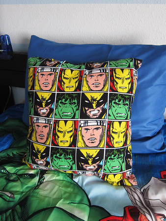 I thought about buying the sheet set just to get a pillow case that looked just like this.  But we really don't need sheets, plus the sheet set was $20!  So I found this fabric at Joanne's and made a pillow, $3.