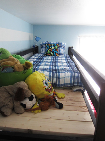 I wanted to show the extra area on Travis' bed.  He was so happy to have extra space for his junk, I mean, treasures.