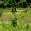 Juan mowing some grass before AMain arrives. We want the place to look nice. You can see bits of plant life flying around the heli in the photo.<br /> Photo by James Plastine