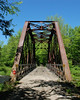 An old steel railroad bridge on the rail trail