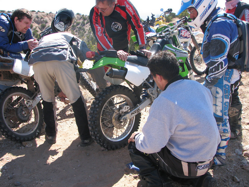 How many adventure riders does it take to loosen an axle bolt?
