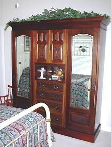 Guest room - Early 20th century Edwardian princess wardrobe. The iron bed is from the Georgia farmhouse